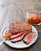 Grilled flank steak with a cherry tomato sauce