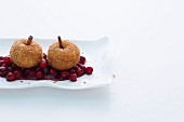 Breaded apple dumplings on cranberry compote