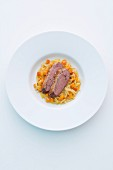 Duck breast with Greek rice noodles and pumpkin