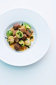 Wild boar meatballs with chestnut gnocchi and Brussels sprouts