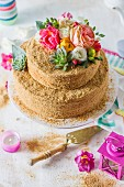 Russian honey cake with decorated with colourful flowers