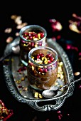 Chocolate and avocado cream with pistachio nuts and pomegranate seeds