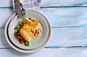 Fish fillets on a lentil medley