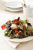 Oak leaf lettuce with red fruits