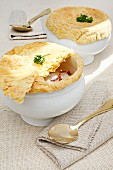 Broth with custard Royale and a puff pastry topping