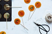 Homemade honey lollies with mint leaves