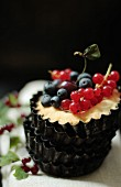 A tartlet with berries and a cherry
