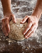 A man baking a loaf of rye bread