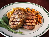 Grilled pork chops with sage, apple sauce and a carrot medley