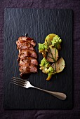 Filet mignon with Romanesco broccoli and kohlrabi on a slate platter