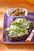 Dark bread topped with Roquefort, apples, avocado and cashew nuts
