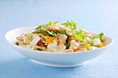 Farfalle pasta with fish, feta cheese and rocket