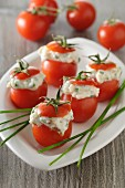 Cocktail tomatoes filled with goat's cream cheese and anchovies