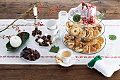 Sweet Christmas buffet with biscuits, chocolate and coffee