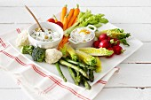 Raw vegetables with various dips