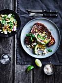 T-Bone Steak with pickled chili, corn & avocado