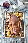 Roast duck with apples and sloes