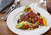 Lamb fillet with vegetables on a bed of risotto