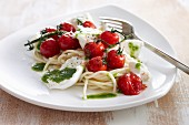 Spaghetti with oven-roasted tomatoes, mozzarella and basil sauce