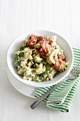 One vegetable salad with potatoes, chart, cheese and bacon