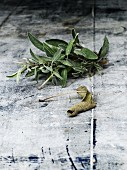 Sage, fresh and dried, on light wood