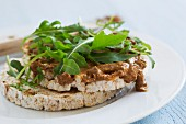 Rice waffles topped with almond butter and rocket (close)