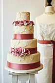 A wedding cake decorated with roses