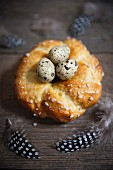 A yeast dough wreath with quail's eggs for Easter