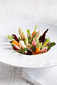 Various vegetables standing upright on a plate