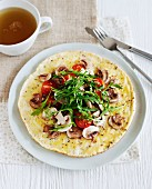 A healthy omelette with tomato, rocket and mushroom