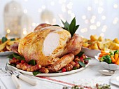 Carved roast turkey with sides for Christmas dinner