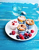 Blueberry and raspberries muffins with quark cream