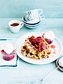 Waffles with cherry compote and whipped cream