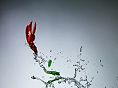 A lobster claw and mange tout with a splash of water