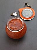 Rhubarb jam in an opened preserving jar