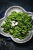 Young peas with garlic butter