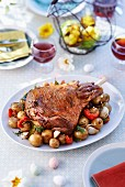 Roasted leg of lamb with potatoes for Easter