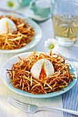 Poached egg on potato straw for Easter