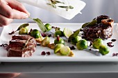 Beef leg with sage and Brussels sprouts