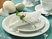 A napkin ring made from silver birch sprigs on an Easter place setting