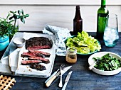 Grilled flank steak, steamed spinach and lettuce