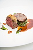 Braised beef shoulder and rare roasted beef fillet on stem purée