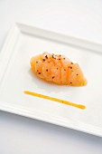 Brook trout carpaccio with orange and colourful pepper