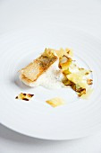 Crispy roast zander with a potato and cabbage medley and a white wine foam