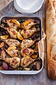 Chicken legs with lemon, shallots and olives