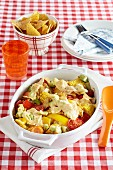 Gratinated vegetables with tortilla crisps and cheese