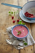 A smoothie bowl with raspberries and banana