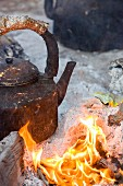 A kettle over an open fire