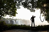A man standing at Victoria Falls, Africa