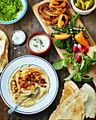 Mezzo platter with hummus, pita bread and roasted vegetables